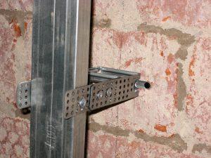 Как прибить гипсокартон к кирпичной стене
